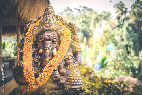 Close up Bronze Ganesha statue and Golden texture Canvas Print