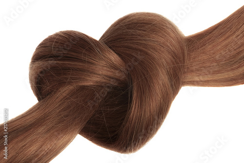 Obraz Brown hair knot in shape of heart, isolated on white background - fototapety do salonu