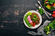 Lentil with radish, cherry tomatoes, beans and vegetables. Healthy food. On a black wooden table. Top view. Free space for text.