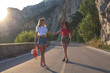 two best friends are walking along the mountain road