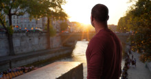 African-American Male Traveling In Paris Watches Beautiful Sunset