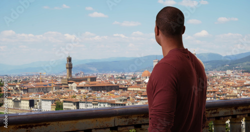 Fotobehang Florence Black male tourist traveling in Italy admiring Florence cityscape