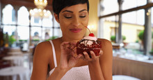Black Woman Takes Messy Bite O...