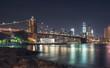 Manhattan skyline at night and Brooklyn bridge