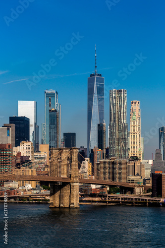 Fotografie, Tablou  Brooklyn, NY / USA - JUL 31 2018: Lower Manhattan Skyline in clear daylight in t