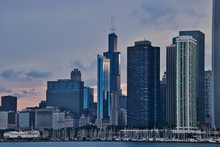 Sunset Reflecting Off Of Skyscrapers, With View Of Sailboats In A Lake Michigan Marina In Foreground, Along Lake Michigan's Lakefront In Downtown Chicago.