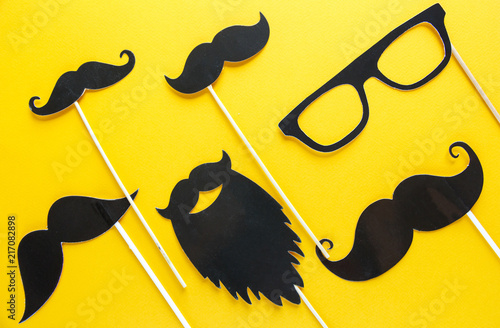 Moustache photo booth props on blue background Wallpaper Mural