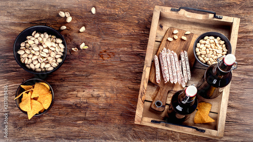 Spoed Foto op Canvas Bier / Cider Beer and snacks on wooden background