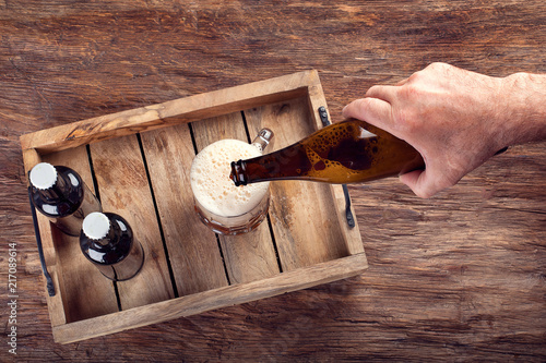 Spoed Foto op Canvas Bier / Cider Man pouring beer into glass