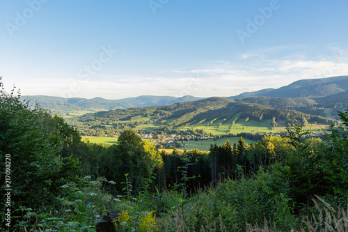 Spoed Foto op Canvas Blauwe hemel Majestic landscape of mountains and Meadow. Cycling mountain road. Misty mountain road in high mountains.. Cloudy sky with mount