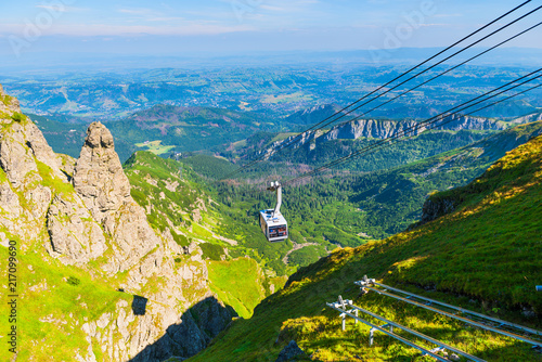cable car on ropes, going to the mountain Kasprowy Ver, Poland. Beautiful view of the valley