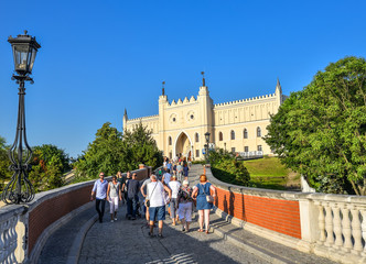 Lublin, Poland - August 11, 2017: The Royal Castle of Lublin, bridge with tourists and bright blue sky. Lublin is the biggest city in eastern Poland.