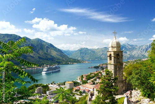 Photo Stands Ship Church tower and venetian architecture of an old Mediterranean town, Bay of Kotor