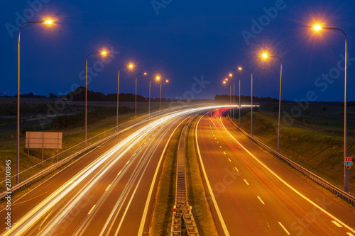 Spoed Foto op Canvas Nacht snelweg Traces of lights on the night highway