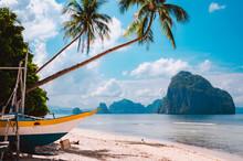 Banca Boat On Shore Under Palm Trees.Tropical Island Scenic Landscape. El-Nido, Palawan