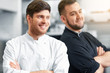 cooking, profession and people concept - happy male chef and cook at restaurant kitchen