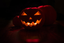 Halloween And Holidays Concept - Spooky Jack-o-lantern Or Carved Pumpkin Lantern Burning In Darkness