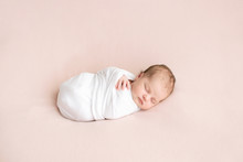 Newborn Girl In White Wrap On ...