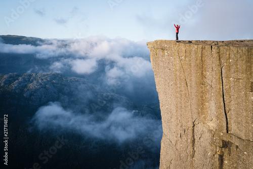 Valokuva  Girl on the Rock Preikestolen, Norway