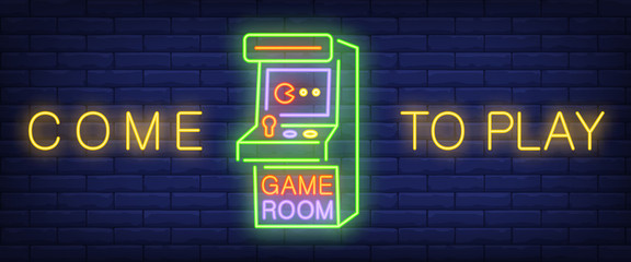 Come to play, game room neon text with arcade game machine. Technology and en...