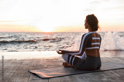 Strong young fitness woman meditate.