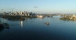 Smooth still waters of Sydney harbour in early morning around Fort Denison towards city CBD landmarks on waterfront.