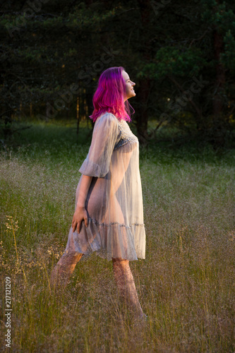 Fotobehang Akt Beautiful young seminude woman in blue transparent dress
