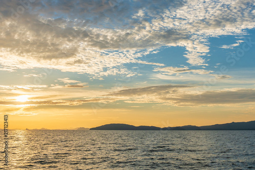Staande foto Strand Sunset at beach sea sky clouds twilight time