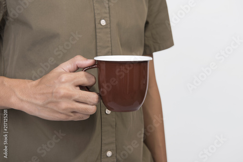 Hand Holding brown coffee cup. mockup for creative design branding.