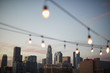 canvas print picture - View Of Los Angeles Skyline At Sunset  With String Of Lights In Foreground