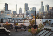View Of Los Angeles Skyline At Sunset From Roof Terrace