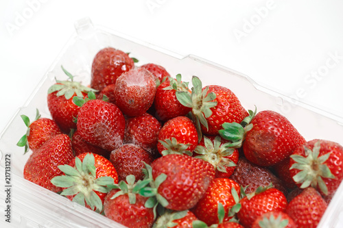 Closeup macro shot image of rotten strawberry with white large mold placed in plastic box Tablou Canvas