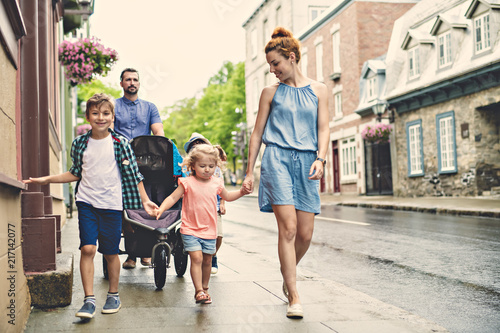 Fotografie, Obraz  happy family with childs in city.
