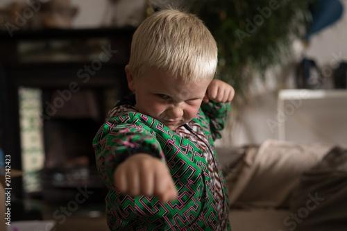 Boy performing martial arts in living room