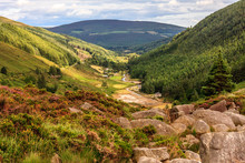 Looking Down A Valley Towards A Town In Wicklow National Park
