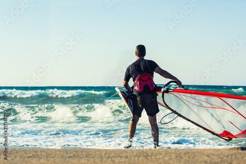 Windsurfer in the sea on Crete on sunset. Windsurfing in Heraklion