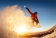 Snowboarder Jumps Sunset With ...