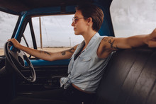Attractive Woman Driving An Old Truck