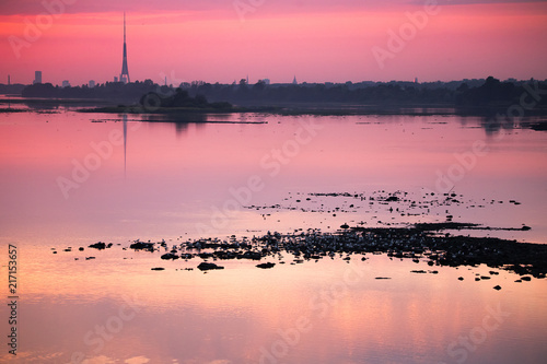 In de dag Candy roze Bright, colorful evening landscape over the river Daugava of pink and purple tones. Dramatic sunset scenery in Latvia, Northern Europe.