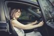 asian woman fasten car seat belt before take a driving