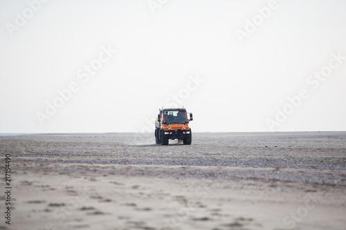 Fotografie, Obraz  Lkw offroad driving on beach - transportation
