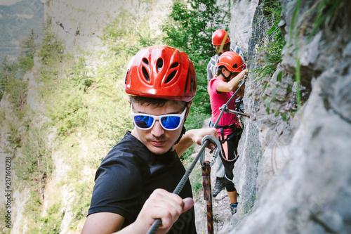 Friends who are climbing along a via ferrata