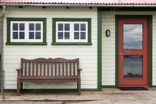 Bench on the terrace in front of a traditional Icelandic house