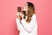 Portrait Of A Happy Young Woman Kissing Chocolate Bar