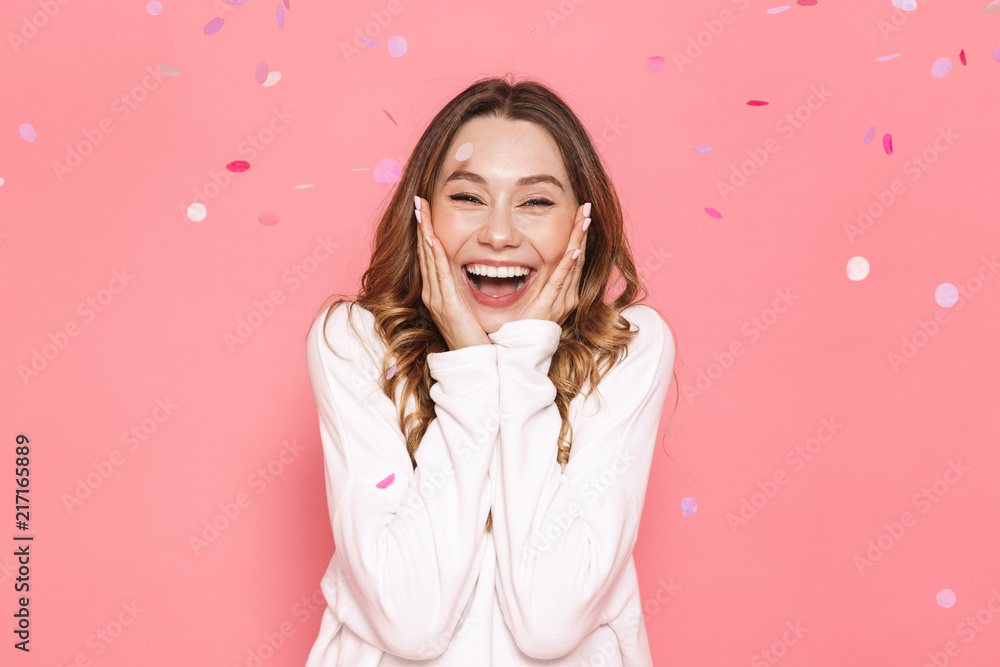 Fototapeta Portrait of an excited young woman celebrating