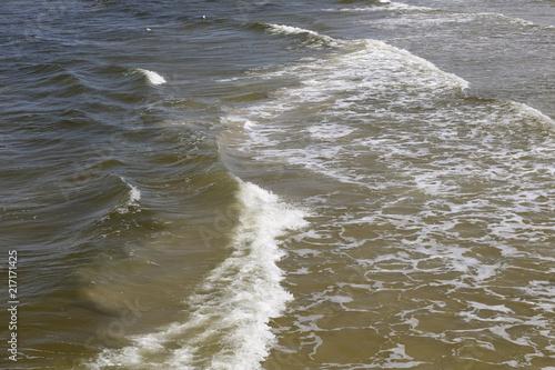 Fotobehang Water Baltic Sea waves reach the shoreline