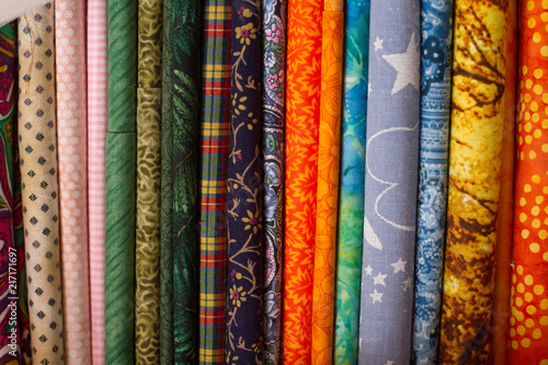 Fotobehang Stof Fabric stack of assorted patterns for sewing and quilting!