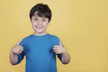 Little Boy Smiling Showing Thu...