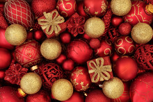 Red And Gold Christmas Bauble Decorations Forming An Abstract Festive Background. Traditional Christmas Greeting Card For The Holiday Season.