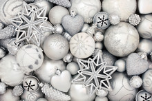 Silver And White Christmas Bauble Decorations Forming An Abstract Background. Traditional Christmas Greeting Card For The Holiday Season. Top View.